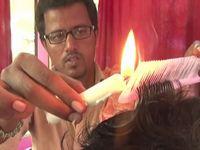 ロウソクの火で散髪するインドの理容師が斬新すぎるwww