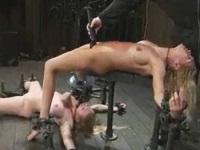 両手と両足を拘束されて調教される女性達